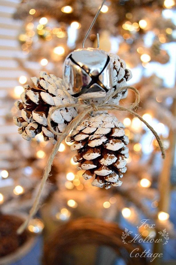 Jingle Bell Pinecone Ornaments. Create a simple, rustic looking natural Pinecone ornament with a Jingle Bell twist for your Christmas tree decoration or used as holiday gifts. .
