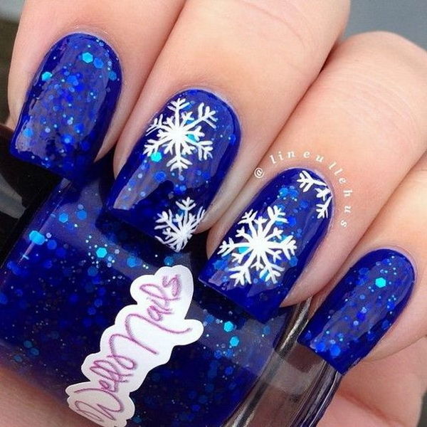 Snowflakes Design on Blue Glitter Nails.