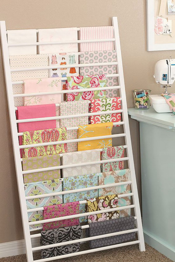 Crib Side Repurposed Into Fabric Storage. Don't throw out the old crib! Repurpose the old crib side to organize and display tons of fabric in your craft room!