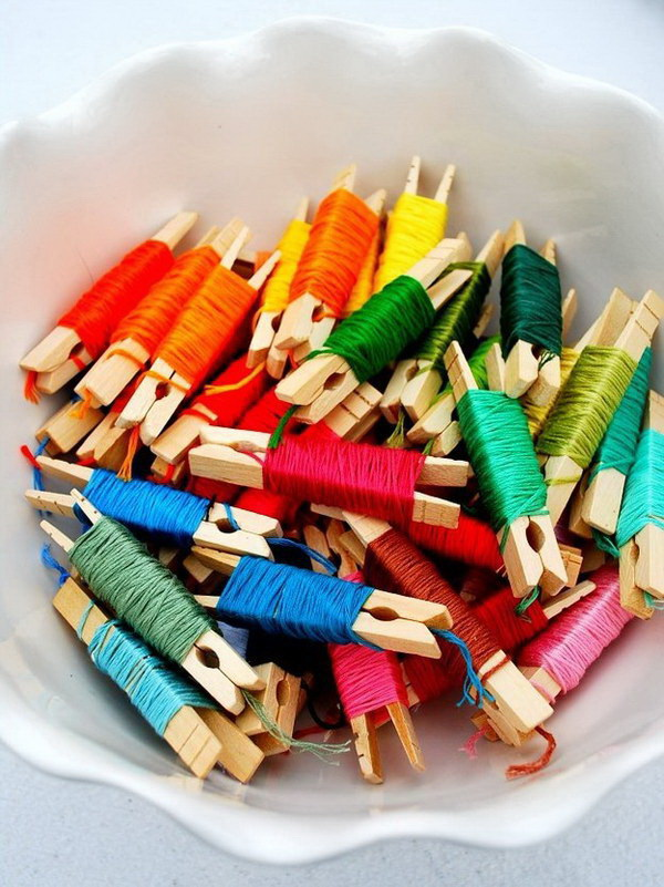 Organizing Embroidery Floss with Clothpins. Here is a great way to display and keep the giant pile of embroidery thread from getting tangled and lost and easy to access with wooden clothpins!