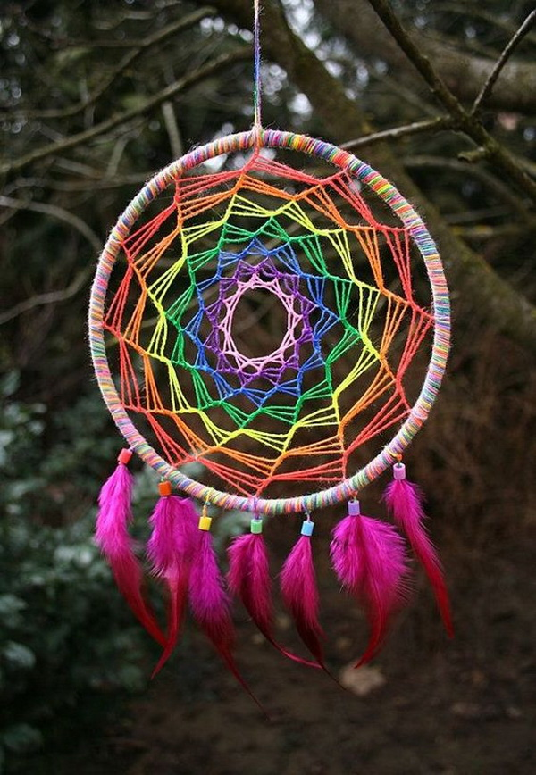 Colorful strings dreamcatcher. A great way to use up all those strings lying around your dresser by weaving this amazing and bright dream catcher.