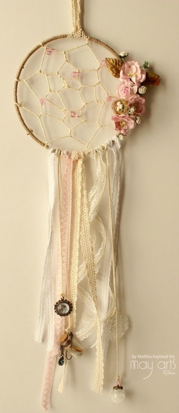 Floral shabby chic dream catcher. Simply crochet for the hoop design and decorate with artifial flowers, leaves, beads and lace for a delicate and shabby chic look.