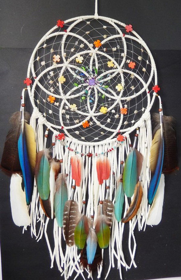 Circle of Life Dream catcher. Create a great piece of artwork with circles for the hoop design. Then decorate with different colored feathers and small decorative items for more elegant and eye-catching look.