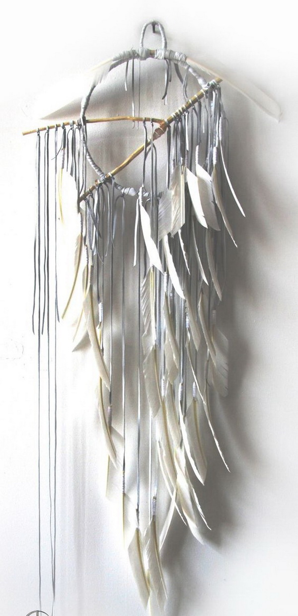 Feather dream catcher. Rustic twig in the center and whimsical fabrics and feathers for details. Elegant gray piece of art!