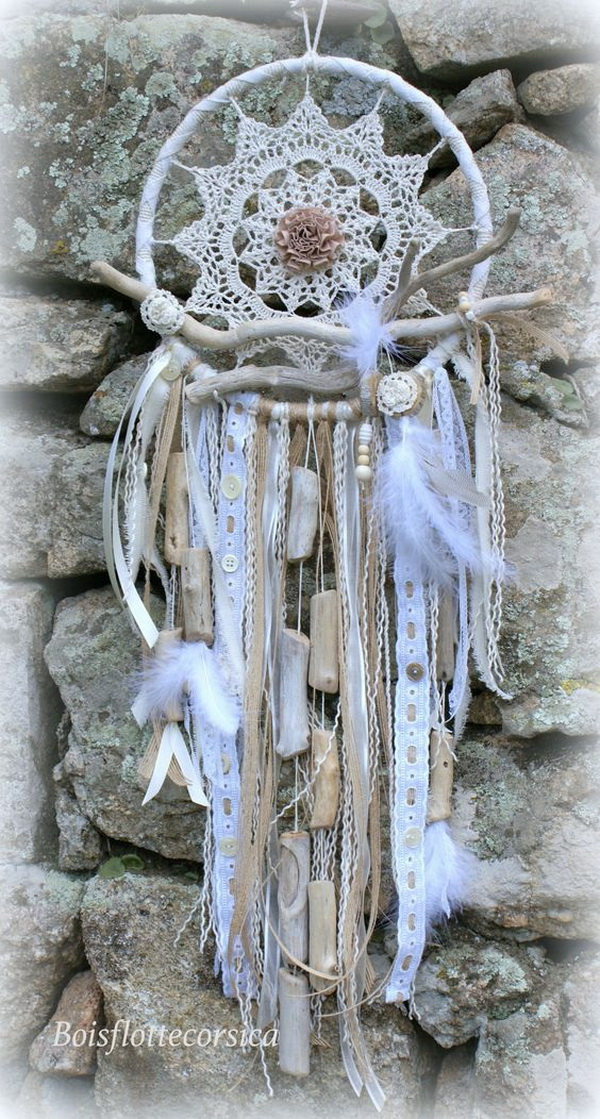 Large Shabby chic crochet dream catcher. This one has a floral crochet patter for the loop design and different ribbons and twins for the lower part.