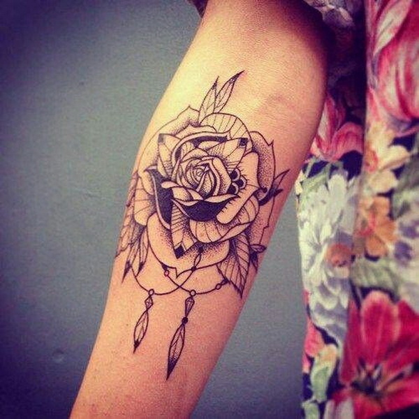 Flower dream catcher tattoo.