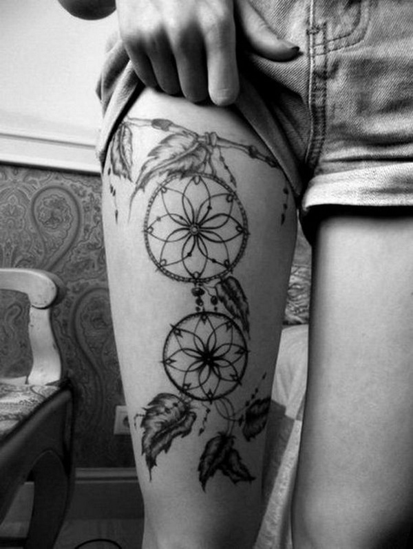 Black and grey dreamcatcher tattoo on the thigh.