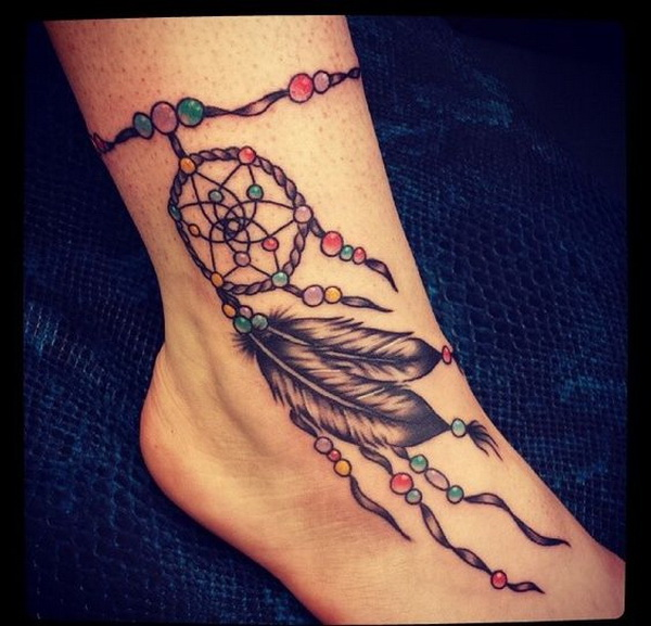 Dreamcatcher tattoos on the ankle.