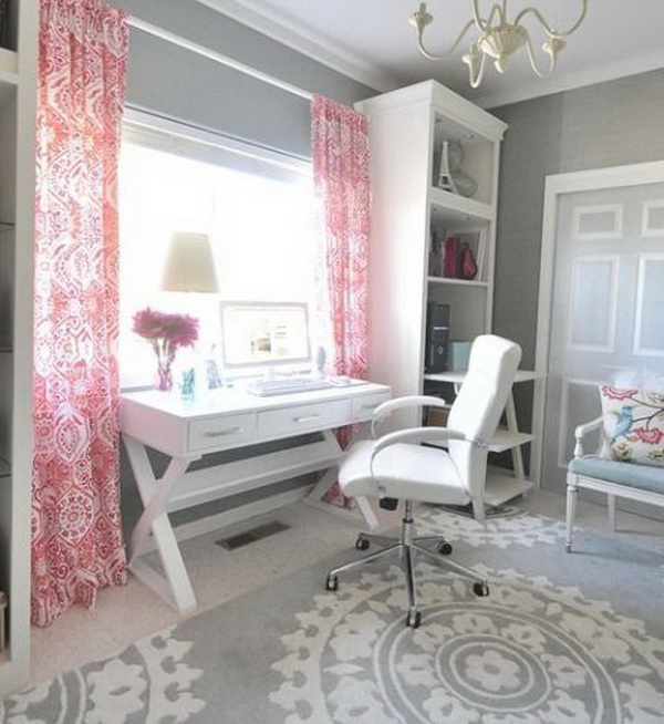 The colorful, patterned drapes and rugs add more interest and feminine glamour to this neutral home office.