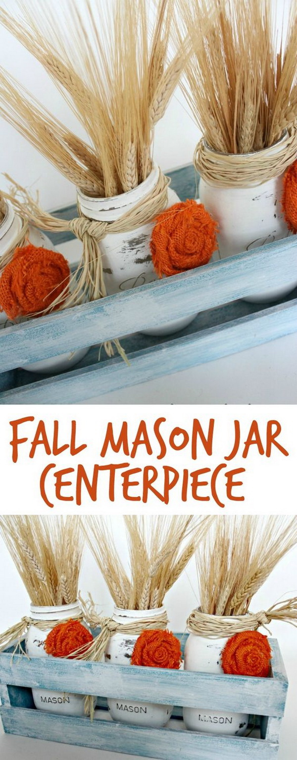 Fall Mason Jar Centerpieces. Paint the mason jars in distressed white and decorate them with handmade  burlap 'flowers'. Set them in the crate, added some wheat stems! Great Easy Fall Mason Jar Centerpieces for parties or fall weddings too!