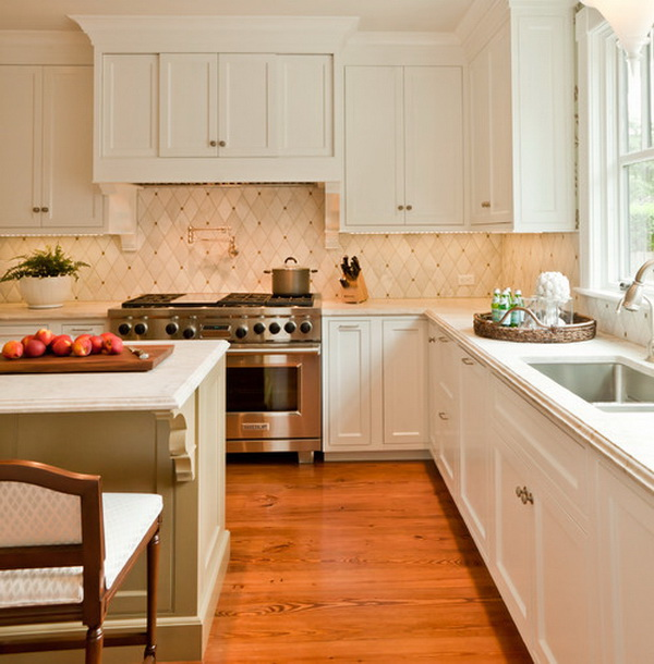 Love the diamond-patterned backsplash with cream and copper accent. It goes well with the wooden flooring.