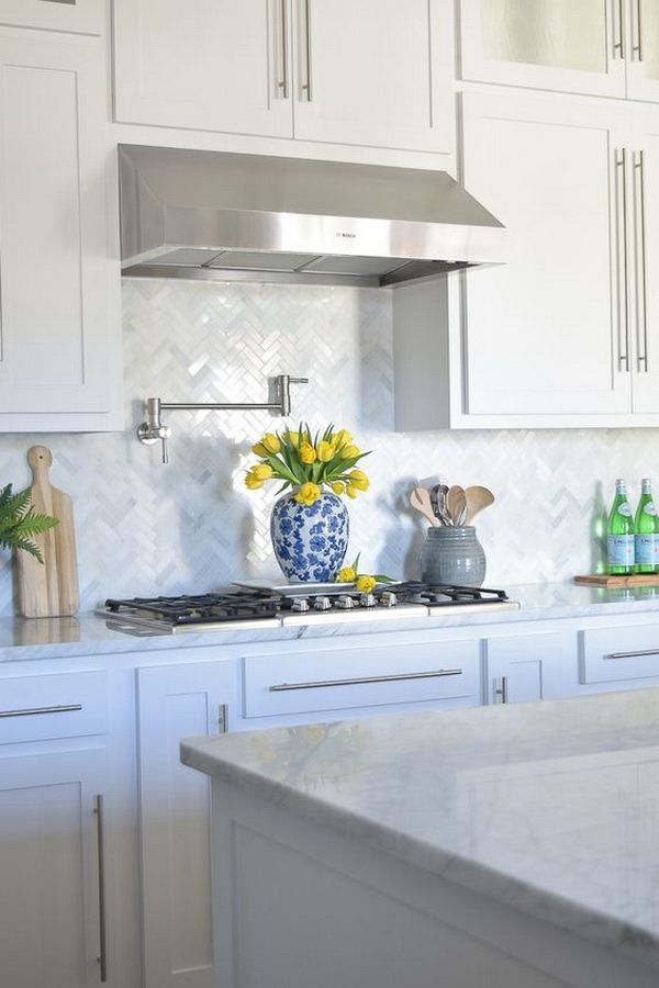 White marble herringbone kitchen backsplash.