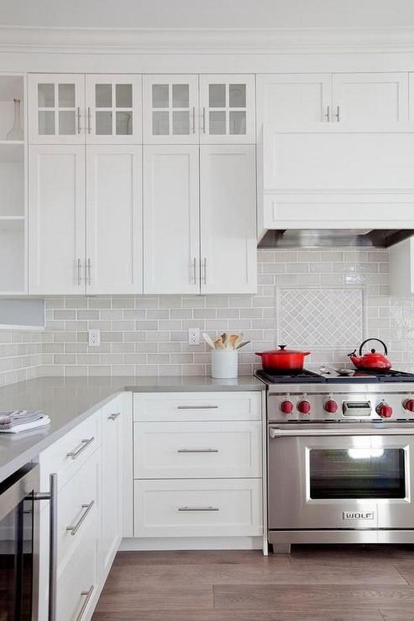 Light gray mini subway tiles framing diamond pattern for kitchen splash back.