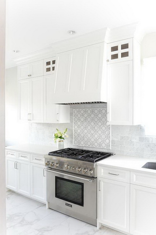 White and gray mosaic tile cooktop framed by mini brick marble backsplash tiles.