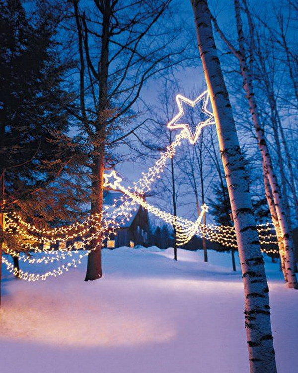Shooting Star Lights Display. These shooting stars were so inexpensive and easy to make and really striking in our yard.really create striking effect this holiday season in your yard.