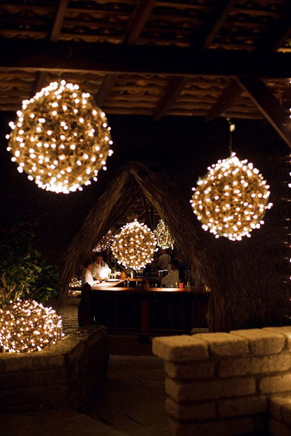 DIY Holiday Light Globe. These round globe lights look especially btilliant and elegant! Amazing holiday light and just perfect for outdoor decoration with much more rustic farmhouse charm. They make wonderful year-round decorations, but you can customize them with some holiday ribbons, lights or other accents to make them even more festive.