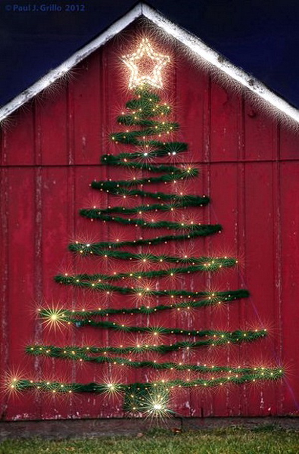 Lighted Garland Christmas Tree. Lovely garland Christmas tree on a red barn wall! This would look great on a large building or the side of your house.
