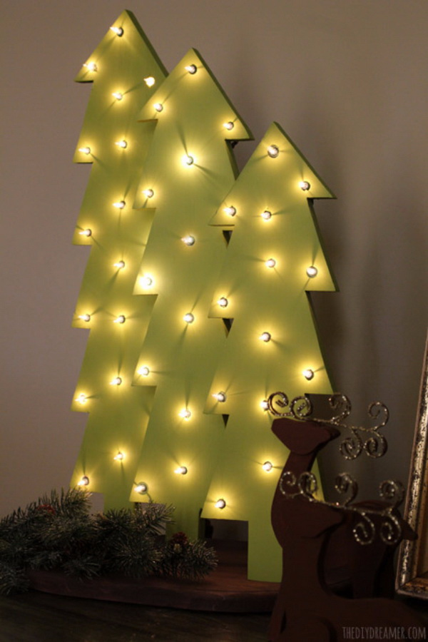 Wooden Christmas Tree With Lights. Make a set of wooden Christmas trees with lights. This project would be so perfect and bright for your mantel decoration and will surely brighten up you home this holiday!