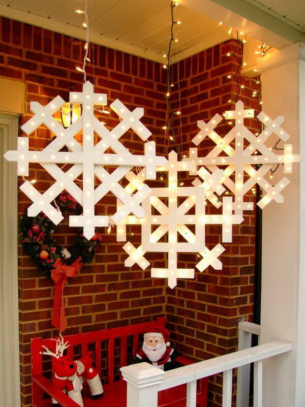 Wooden Snowflakes with Lights Tutorial. Make these beautiful wooden snowflakes with lights to hang from your front porch. They will surely add that extra holiday sparkle!