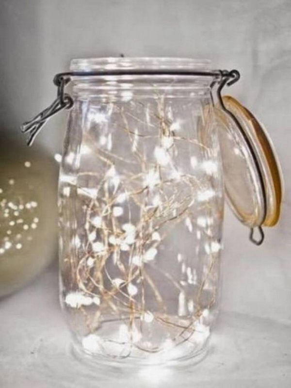 Christmas Lights in a Jar. Placing a lot of led lights into a simple jar and lighting them. This is such an easy but eye-catching decor that will definitely cheer and perk up your home.