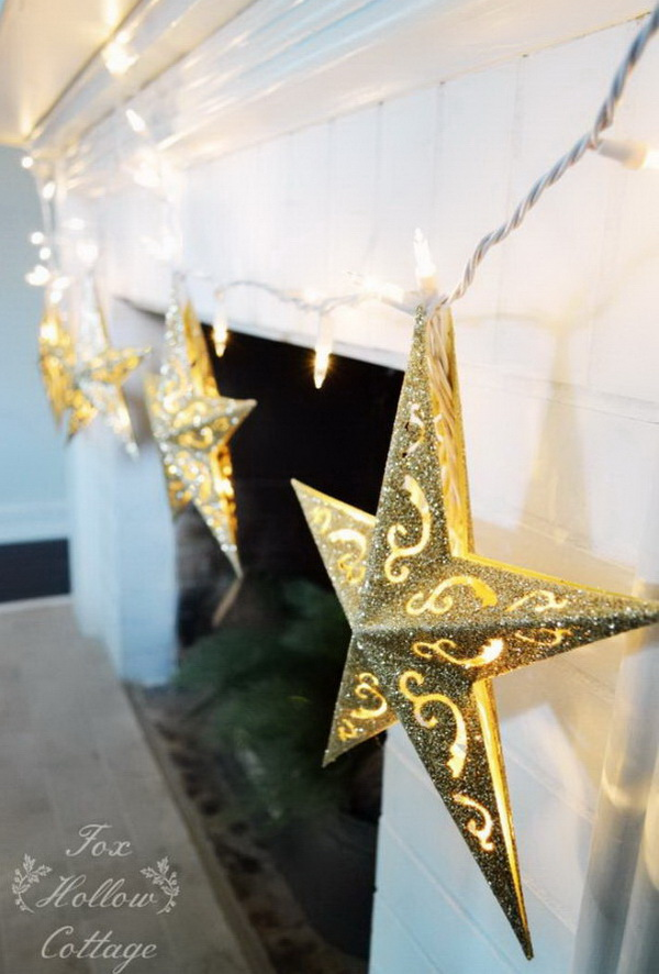 DIY Dollar Tree Christmas Ornament Lights. Your mantel will be filled with Christmas cheer with these beautiful and sparkly star light garland. So darn cute!! I love this good glitter project!