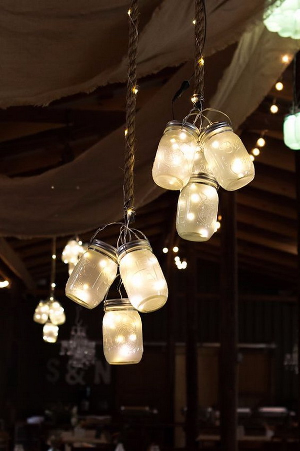 Frosted LED Mason Jar Lights. Make some clusters of frosted LED mason jar lights and hung from the ceiling at this rustic barn! The rustic feel come out beautifully and romatic for a winter wedding.