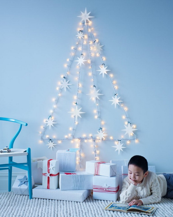 String Light Christmas Tree. Create a string light Christmas tree on the wall. This is an amazing way to save space in a small apartment or dorm room where a Christmas tree is impractical. Felt star ornaments spruce it up.