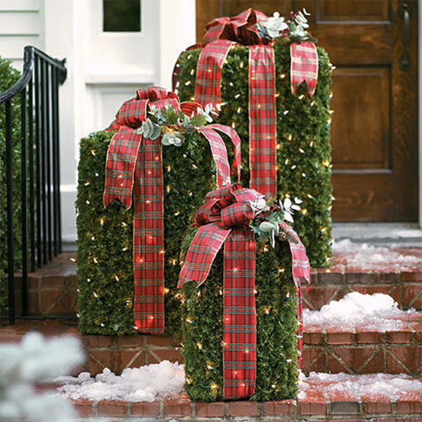 DIY Greenery Boxes with Lights and Plaid Bows. Fresh evergreen boxes embellished with lights and wrapped with plaid bows give your home a vintage, country Christmas look.