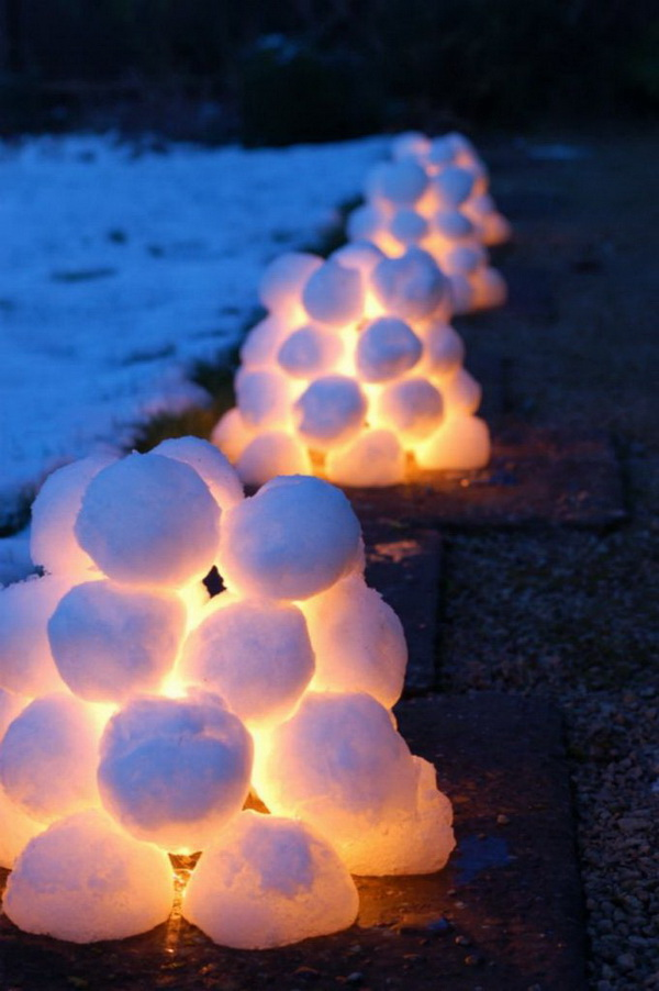 Snow Ball Lights. Lights covered with snow balls to make snow lanterns. A perfect outdoor project to lighten up your front porch!