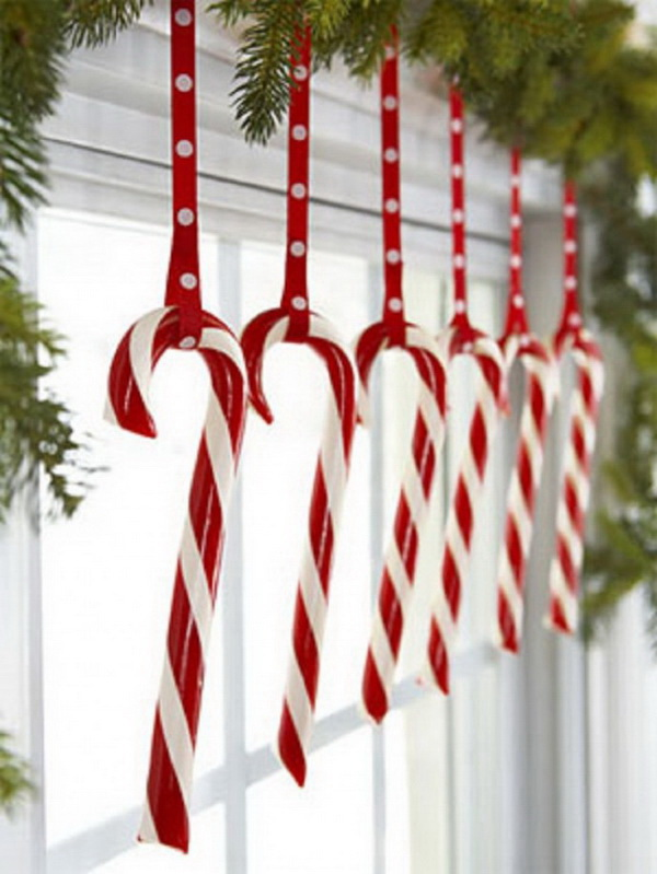 Homemade Projects & Ideas for Christmas Decoration: Hang candy canes in kitchen window for an easy Decoration.