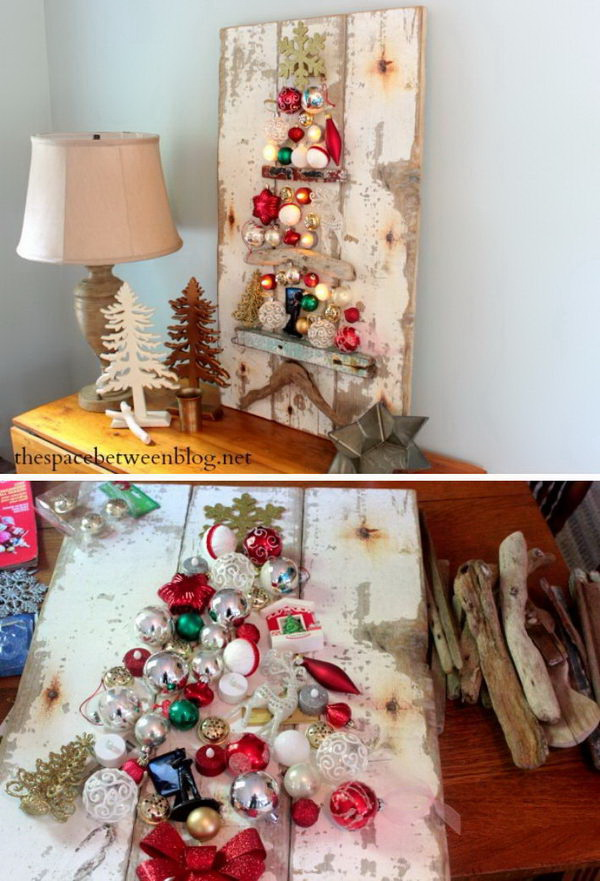 Homemade Projects & Ideas for Christmas Decoration: Rustic Christmas Tree Craft Using Driftwood And Ornaments. Paint the driftwood in one layer of paint or none at all for that organic feel, and create a tree using crystal balls and other ornaments.