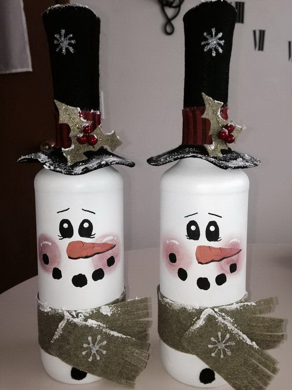 DIY Snowman Wine Bottle Decoration. Wine bottle are such versatile objects for holiday decorations! You can enjoy the winter scenery inside your room with these cutest snowman wine bottle decorations during those cold winter months.