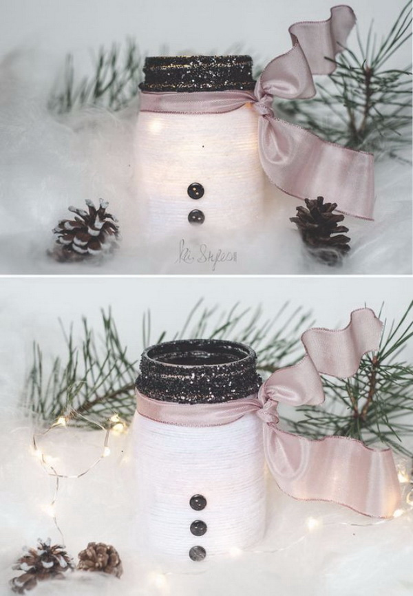 DIY Yarn Wrapped Snowman Mason Jar Luminary. Mason jars make perfect decor for holiday! Wrap a lovely snowman mason jar luminary with yarn and put a flame-less tealight candle inside or you can easily use it as a gift jar.