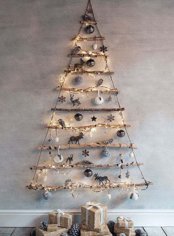 Frosted Branches Hanging Tree. Make a tree shape using found branches and it hung by jute against the wall, wrapped with string lights and decorated with ornaments. This is a clever idea! The rustic warm of this simple tree is just what I want. If you also want a rustic themed Christmas tree this year, find the supplies around your home and make one in no time!