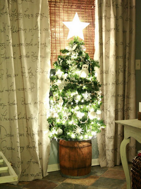 DIY Lighted Tomato Cage Christmas Tree. This DIY Christmas tree is made using lighted garland and a tomato cage. You can find everything you needed at the local hardware and dollar store. It is so simple chic and eye-catching!