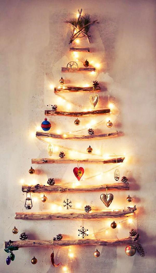 Create a simple and elegant Christmas tree using found branches and simple Christmas ornaments and string lights up against the wall. It is not only a Christmas tree but also a good shelf to display your Christmas treasures.