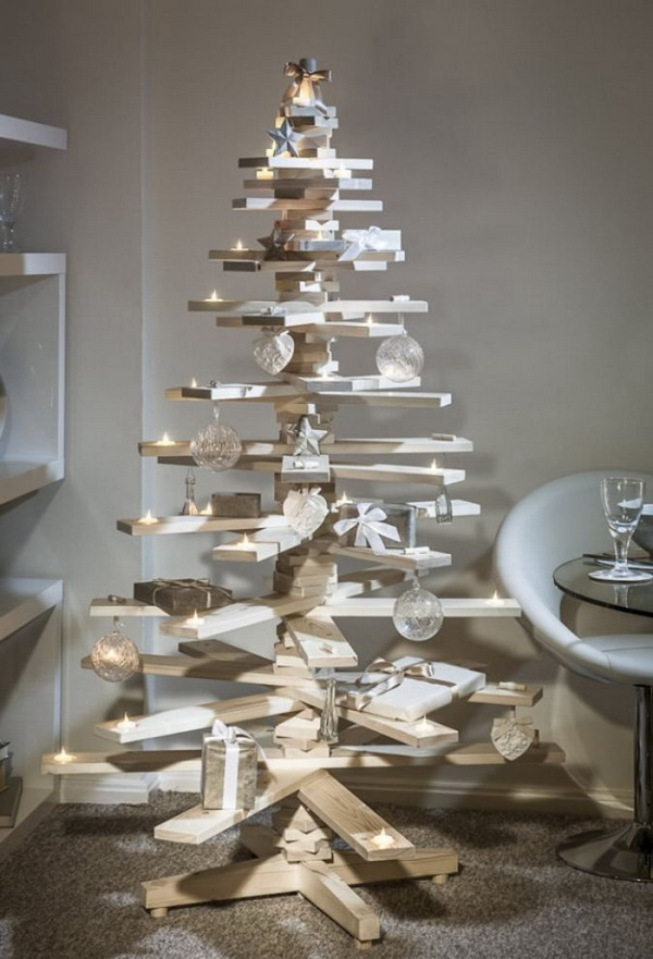 Wooden board Christmas tree adorned with ornaments. Set up your own wooden board in a Christmas tree and add cute and adorable ornaments to enhance the décor.