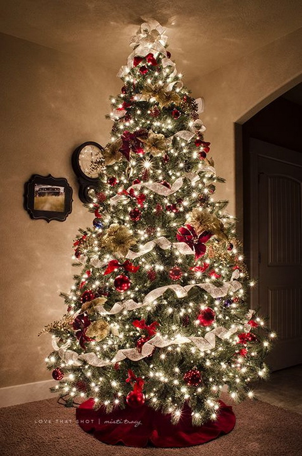 Christmas tree decorated with ribbon and burlap. Adding ribbon to a Christmas tree is a great way to make your Chirstmas tree stunning and outstanding during the holiday season.