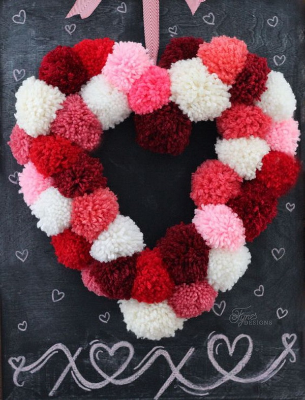 Pom pom heart wreath. A wreath is the most popular and cool idea for decoration. You can easily DIY one with leafover yarn in red, pink and white colors. So easy and perfect!