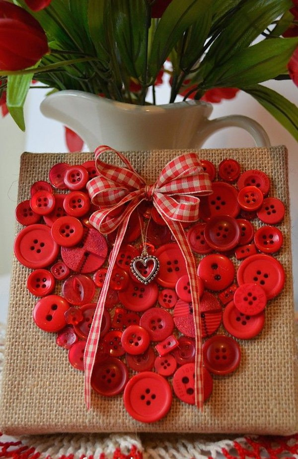 Sew or glue a bunch of little red buttons to form a heart on a piece of canvas. Add a cute bow and heart pendant. It will be the cutest DIY decorations or gifts for Valentine's Day.