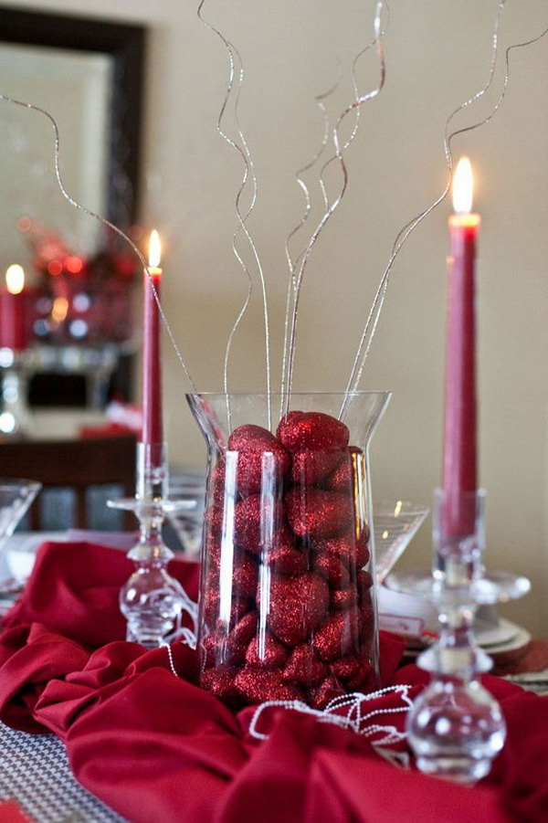 Table Decoration Ideas for Valentine's Day! You can find a clear glasss vase, fill it with some red heart shaped chocolates and add some embellishments. Simple but with filled with romance and love.
