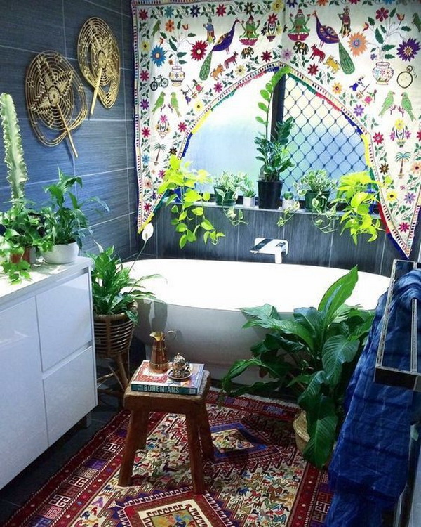 Bohemian style bathroom with lush greenery.