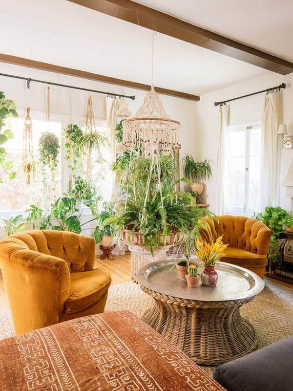 Boho inspired living room with lots of hanging plants.