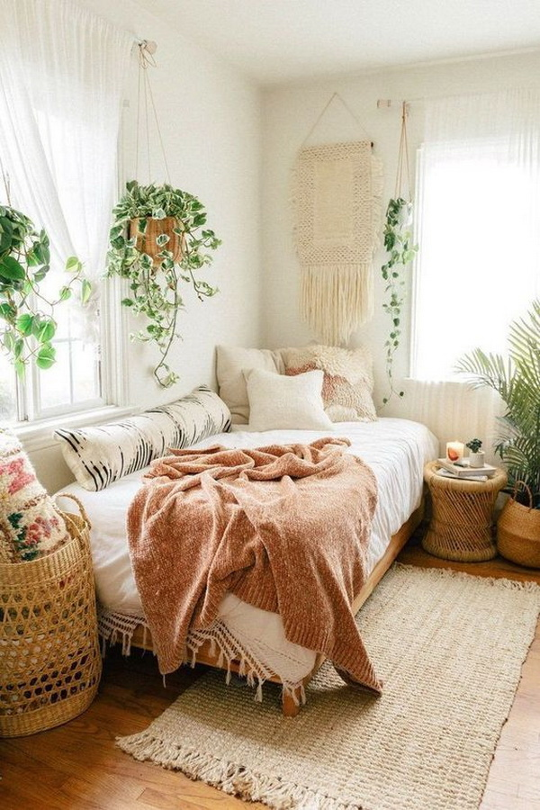 Bohemian bedroom with potted houseplants. You can place the plants on the floor or hanging the plants with a rope.