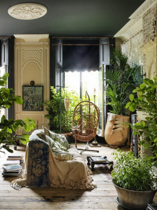 Urban jungle interior design full of fresh plants.