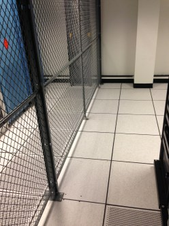 Line Stiffener Posts to Stabilize Data Center Wire Partitions on Raised Floor Tiles