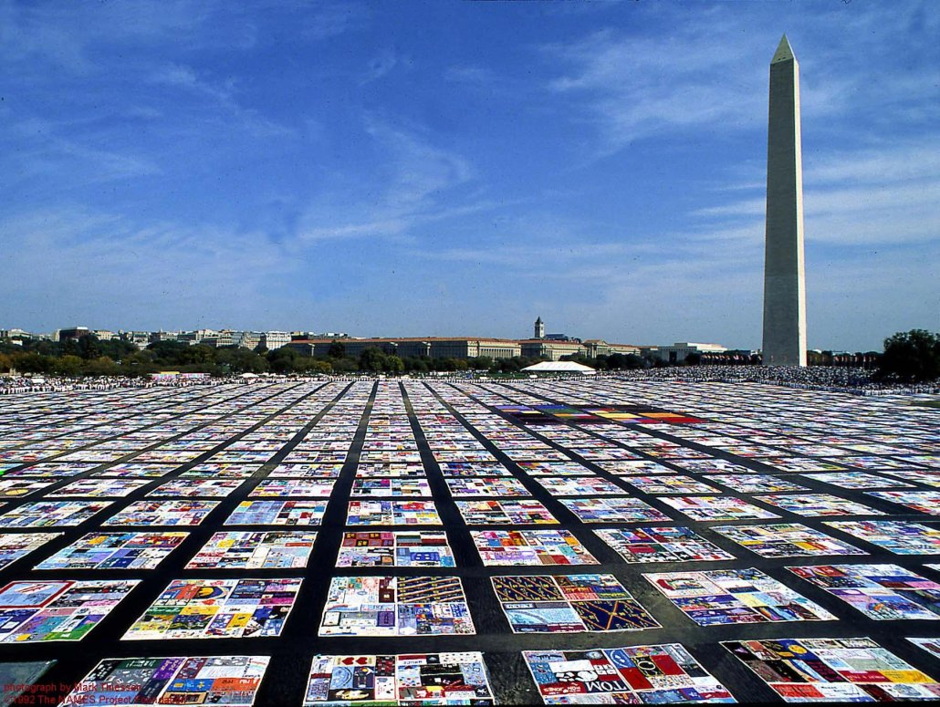 colorful quilts stretch across the national mall near the george washington memorial
