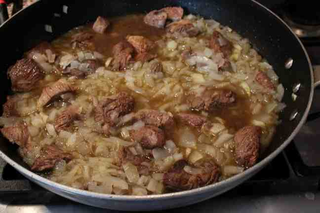 Lamb and onions cooking in skillet