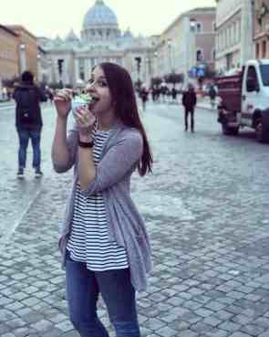 Alexandria eating gelato in front of St. Peter's Basilica