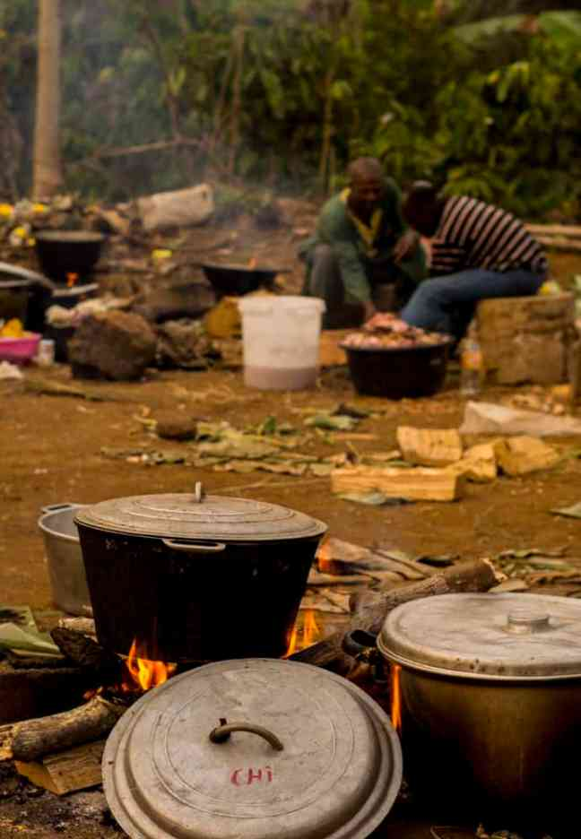 Food cooked in iron pot over wood fire